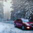 Car driving in winter snow